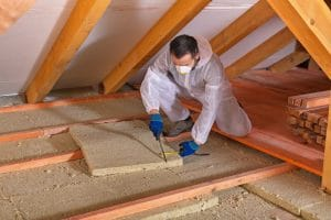 Man laying thermal insulation layer - EcoStar Foam